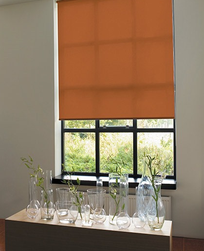 Orange Roller Blind In A Recessed Window